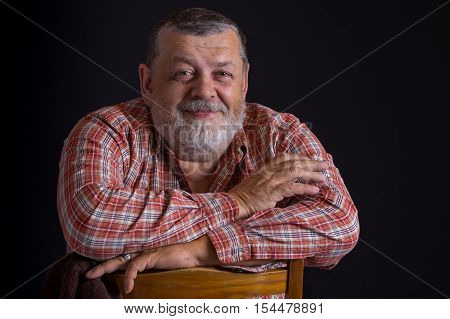 Portrait of happy Ukrainian peasant wearing checked shirt