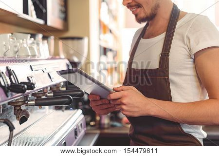 digital tablet in hands of a small business owner in the kitchen