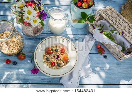 Preparations for breakfast in the garden on old wooden table