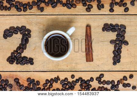 a word of coffee 2017 on wood background
