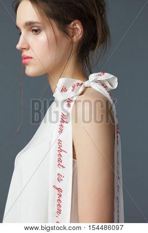 Portrait Of Woman Dressed In A Elegant White Silk Tunic