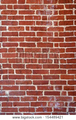 Warped and Grungy Red Brick Wall Background