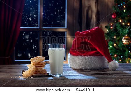 close up view of glass of milk with cookies on color back