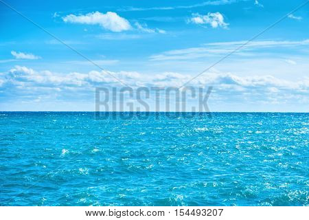 Sea Water And Blue Sky With White Clouds