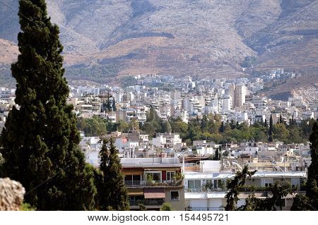a view of the residential area of the city of Athens in Greece and trees