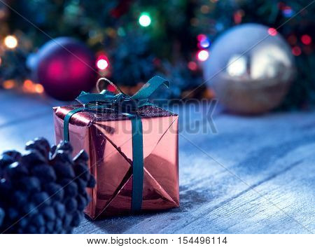 close up view  of  gift boxes and christmas tree  on wooden back