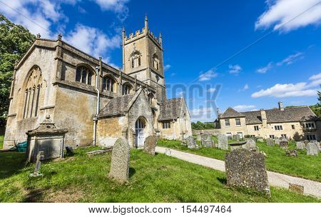 Typical rural English village church and cemetery in the Cotswolds