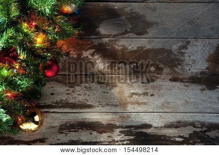 view  of lit decorated Christmas tree  wooden back