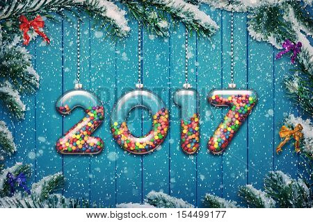 Set of transparent glass with multicolored candy and sweets hang on a snowy Christmas tree branch. New year 2017 background 3D illustration.