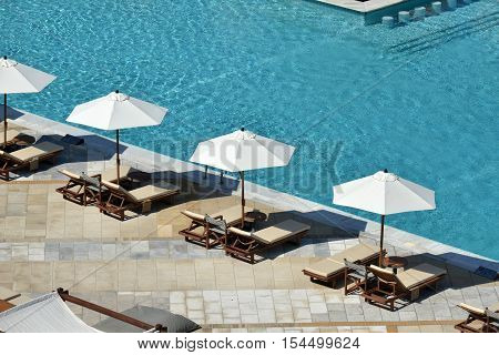 a view from above of sun loungers and sun umbrellas at a hotel