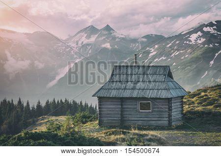 sunrice in mountain near hunting house, toned like Instagram filter