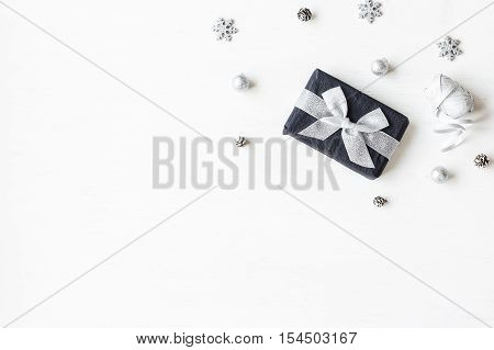 Christmas composition. Christmas gift snowflakes pine cones. Top view flat lay