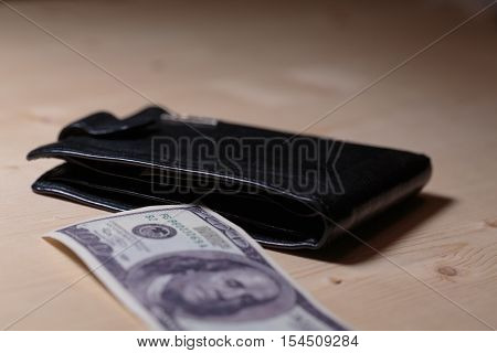 Money in wallet. Wallet full of cash. Cash flow of dollars in wallet