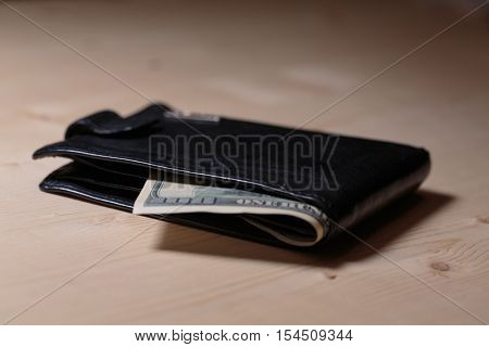 Money in wallet. Wallet full of cash. Cash flow of dollars in wallet