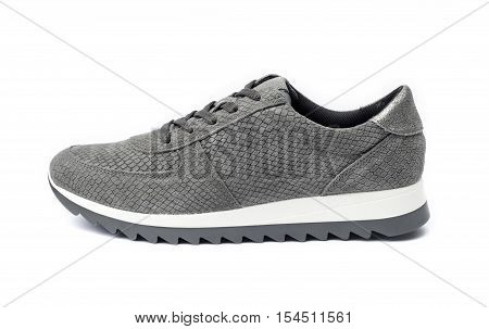 Gray female suede sneaker isolated on white background with clipping path
