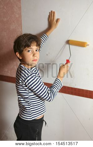 preteen boy help wallpapering boy stick wallpaper close up portrait