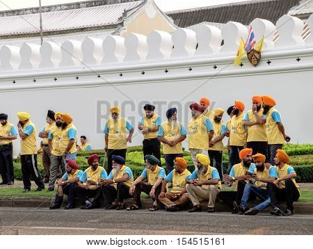 Bangkok, Thailand - December 5, 2015: The group of Sikh people waiting for the procession on celebrating of the King Rama 9 birthday at the walls of the Grand Palace Bangkok Thailand.