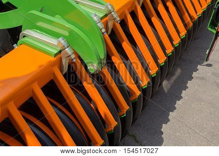 Elements of agricultural machinery close up. Agriculture