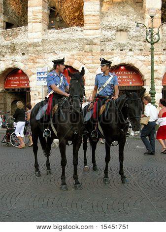 Carabinieri on horseback.