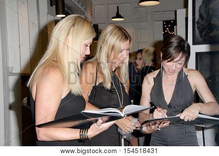 Actress Naomi Grossman autographs copies of