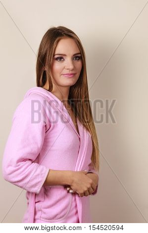 Woman Wearing Pink Bathrobe