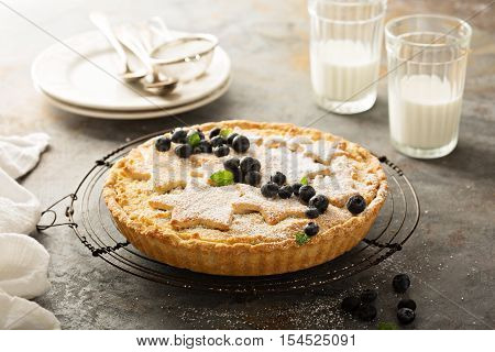 Traditional scandinavian almond tart decorated with powdered sugar