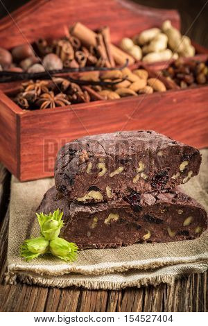 Homemade chocolate with nuts on old wooden table