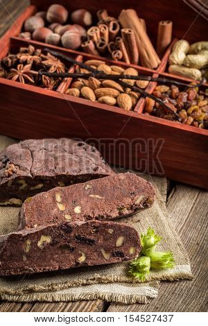 Homemade dark chocolate with nuts on old wooden table