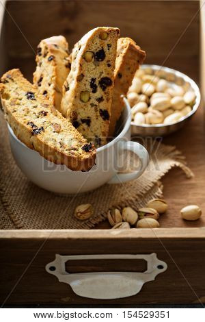 Homemade biscotti with dried fruits and nuts in a big cup