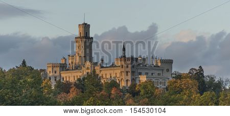 Hluboka nad Vltavou castle in autumn time with sunset