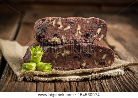 Closeup of homemade chocolate with hazelnuts on old wooden table