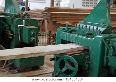 Planing of wood machine in workshop , carpenter , woodshop