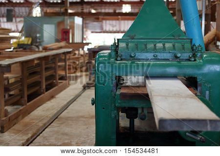 Planing of wood machine in workshop , woodworking machine