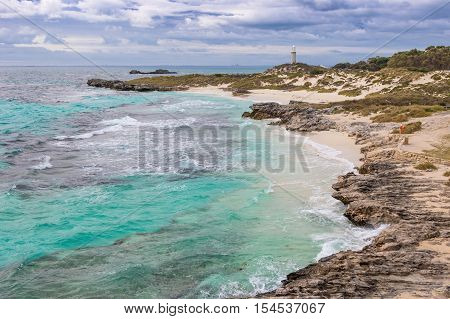 Cloudy skies over The Basin, Pinky Beach and Bathurst Lighthouse at Rottnest Island near Perth in Western Australia.