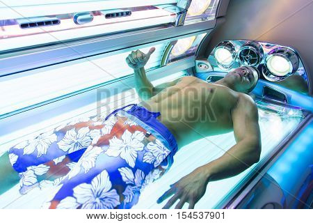 Bodybuilder In Solarium