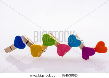 Colorful clothespin attached one another form a zigzag