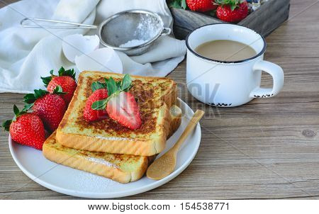 French Toasted with strawberry and Coffee on old wooden Background Breakfast Healthy
