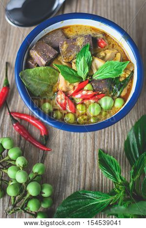 Chicken Green Curry with Herbs on Wooden Background Thai Food Thai Cuisine