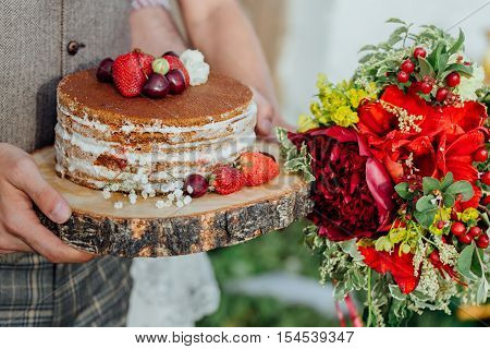 home wedding cake with strawberries and cherries