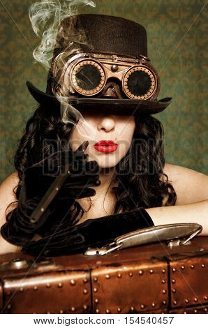 Portrait of a beautiful steampunk woman over vintage background. Photo in old image style