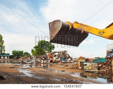 The metal scrap in junkyard are recycling.