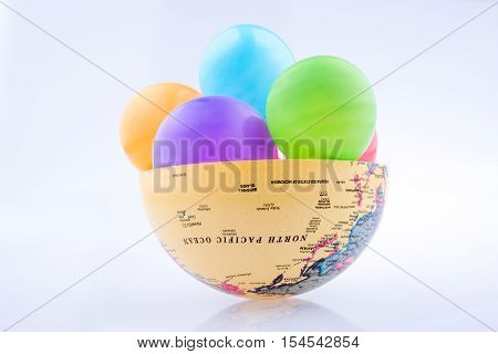 Half a globe filled with colorful balloons