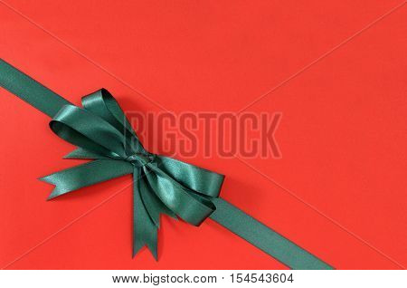 Green Gift Ribbon Bow Corner Diagonal Red Paper Background