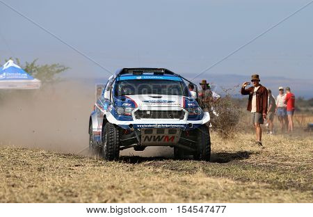 Speeding White And Blue Ford Ranger Rally Car Front View