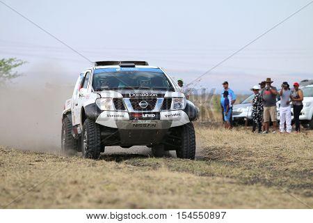 Speeding Black And White Nissan Navara  Rally Car Front View