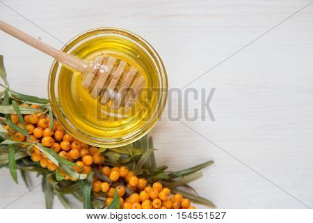 Sea Buckthorn And Honey On A Light Background. Selective Focus