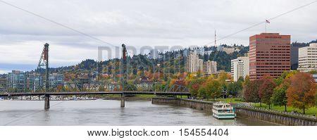 Portland Oregon city downtown waterfront park by Hawthorne Bridge in fall season panorama