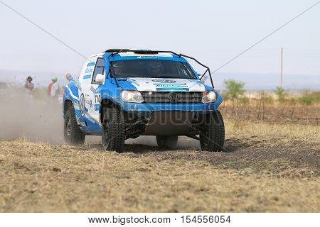 Close-up View Of Speeding Blue And White Vw Amarok Twin Cab Rally Car