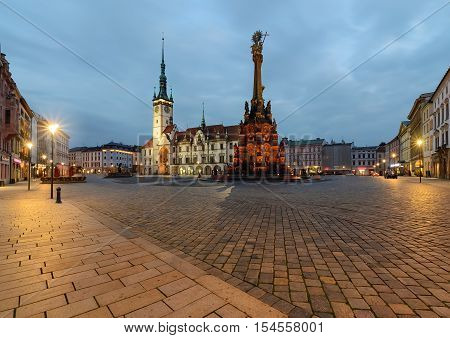 Town hall and Holy Trinity Column in the main square of the old town of Olomouc Czech Republic after sunset.