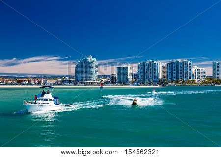 Gold Coast, AUS - SEPT 04 2016 Water sports with the view of Labrador suburb, Gold Coast